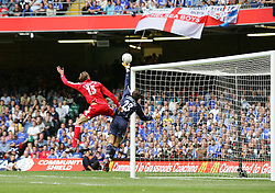 CARDIFF, WALES - SUNDAY, AUGUST 13th, 2006: Liverpool's Peter Crouch and Chelsea's Carlu Cudicini during the Community Shield match at the Millennium Stadium. (Pic by David Rawcliffe/Propaganda)