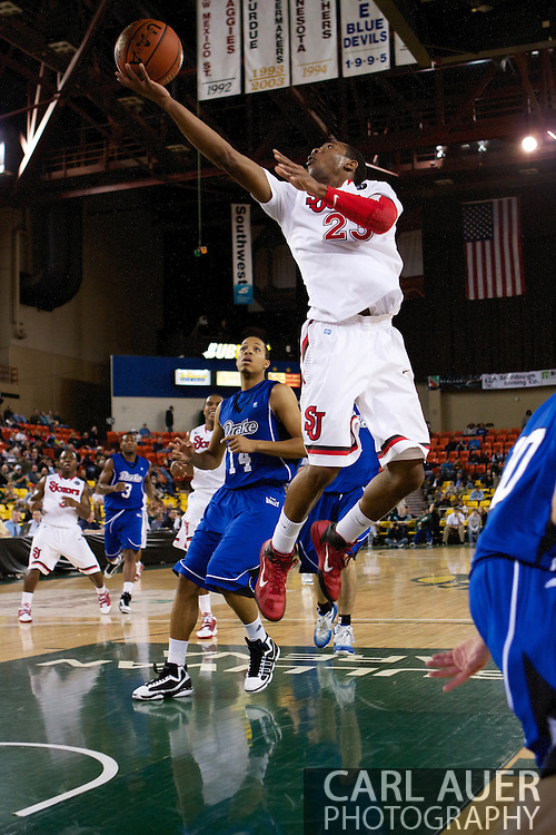 November 26th, 2010:  Anchorage, Alaska - St. John's senior guard Paris Horne (23) finger rolls a shot up in the Red Storm's semi final game of the Great Alaska Shootout against the Drake Bulldogs.  The Red Storm defense held Drake to a tournament low score as St. Johns advanced to the final game 82-39.