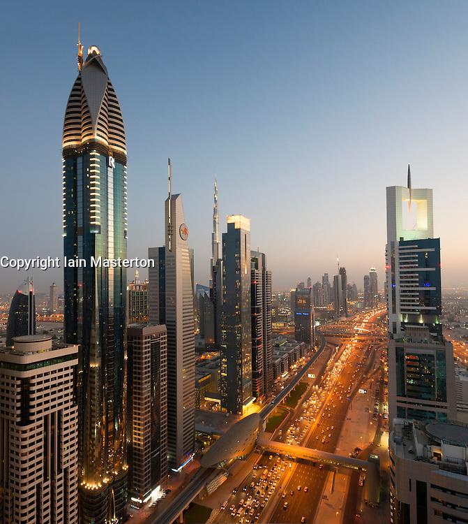 Evening dusk view of skyline of Dubai along Sheikh Zayed Road in United Arab Emirates
