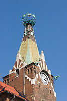 """Bookstore under the globe clock tower with architectural details - Ksigarnia """"Pod globusem"""" - Krakow Poland"""