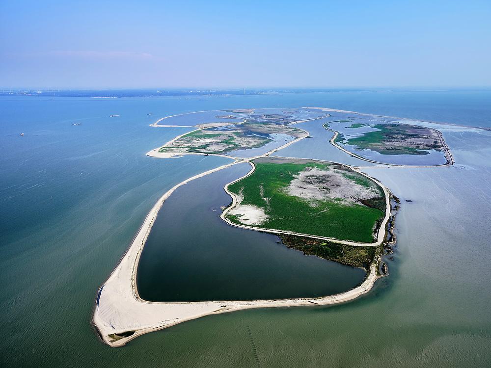 Nederland, Flevoland, Markermeer, 26-08-2019; Marker Wadden in het Markermeer. Gezien vanuuit het Oosten.<br /> Doel van het project van Natuurmonumenten en Rijkswaterstaat is natuurherstel, met name verbetering van de ecologie in het gebied, in het bijzonder de kwaliteit van bodem en water<br /> Naast het hoofdeiland is er inmiddels een tweede eiland in wording, de uiteindelijk Marker Wadden archipel zal uit vijf eilanden bestaan. <br /> Marker Wadden, artifial islands. The aim of the project is to restore the ecology in the area, in particular the quality of soil and water.<br /> The first phase of the construction, the main island, is finished. <br /> <br /> luchtfoto (toeslag op standard tarieven);<br /> aerial photo (additional fee required);<br /> copyright foto/photo Siebe Swart