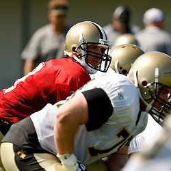 July 31, 2010; Metairie, LA, USA; New Orleans Saints quarterback Drew Brees (9) under center during a training camp practice at the New Orleans Saints practice facility. Mandatory Credit: Derick E. Hingle