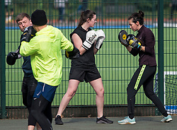 © Licensed to London News Pictures. 04/04/2020. London, UK. A group of people contact boxing at Paddington Recreation Ground in London, during a pandemic outbreak of the Coronavirus COVID-19 disease. The public have been told they can only leave their homes when absolutely essential, in an attempt to fight the spread of coronavirus COVID-19 disease. Photo credit: Ben Cawthra/LNP