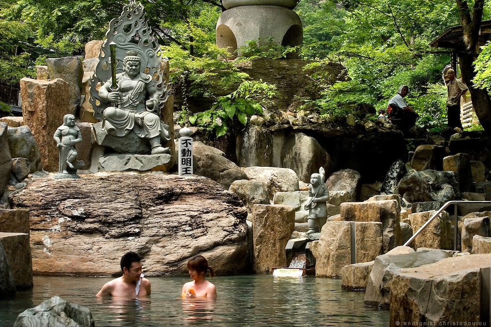 "Bathers in the mixed ""Maka no yu"" (larger hot spring) of the Takaragawa onsen (hot spring) in Gunma prefecture north of Tokyo. The founder of the onsen was a Buddhist and there are many Buddhist statues around and inside the hot springs. - JAPAN 8 July 2006"