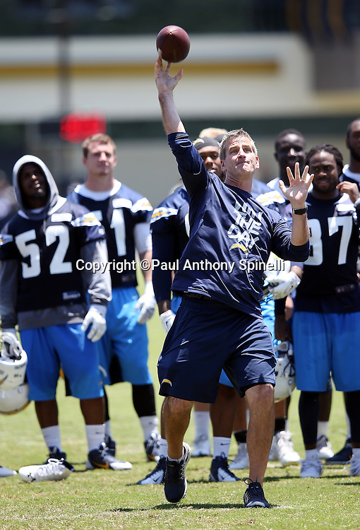 San Diego Chargers offensive coordinator Frank Reich throws a pass during the San Diego Chargers Spring 2015 NFL minicamp practice on Wednesday, June 17, 2015 in San Diego. (©Paul Anthony Spinelli)