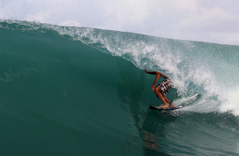 Surfing the barrel at a secret wave in Sumatra.