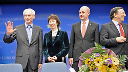 Herman Van Rompuy, Belgium's prime minister, and the first president of Europe, left, Catherine Ashton, Europe's new foreign minister , left center, stands with Fredrik Reinfeldt, Sweden's prime minister and standing president of the European Council, center right, and Jose Manuel Barroso, president of the European Commission, during the press conference following the European Union Summit at the EU headquarters in Brussels, Belgium, on Thursday, Nov. 19, 2009. European leaders set divisions aside today as they chose their first-ever European Union president to represent the 27-nation bloc on the world stage. (Photo © Jock Fistick)