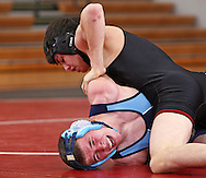 Linn-Mar's Jeremy Severir (from left) tries to turn Jefferson's Zac Builta (from left) in the 130 pound match at the Jefferson at Linn-Mar dual meet at Linn-Mar High School in Marion on Thursday January 14, 2010. (Stephen Mally/Freelance)