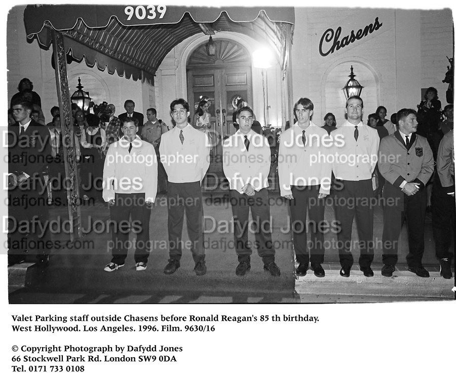 Valet Parking staff outside Chasens. Beforer Ronald Reagan's 85 th birthday. West Hollywood. Los Angeles. 1996. Film. 9630/16<br />&copy; Copyright Photograph by Dafydd Jones<br />66 Stockwell Park Rd. London SW9 0DA<br />Tel. 0171 733 0108