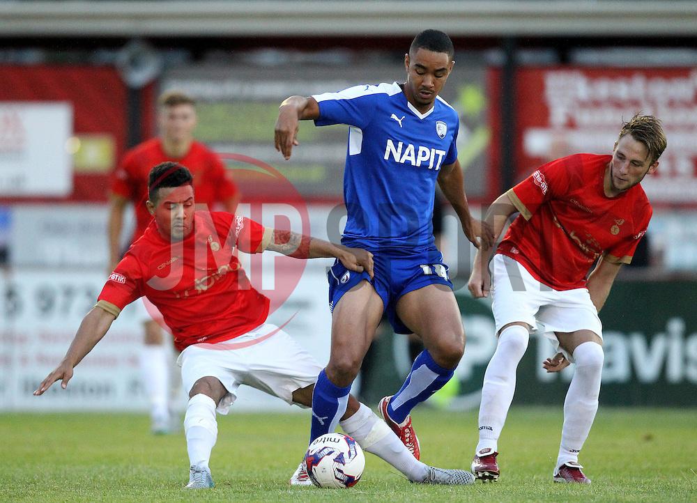 Chesterfield's Byron Harrison takes on the Ilkeston defence - Mandatory by-line: Robbie Stephenson/JMP - 07966386802 - 28/07/2015 - SPORT - FOOTBALL - Ilkeston,England - New Manor Ground - Ilkeston FC v Chesterfield FC - Pre-Season Friendly