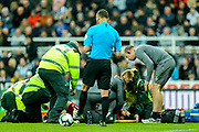 Mohamed Salah (#11) of Liverpool receives treatment after a collision with Martin Dubravka (#12) of Newcastle United during the Premier League match between Newcastle United and Liverpool at St. James's Park, Newcastle, England on 4 May 2019.