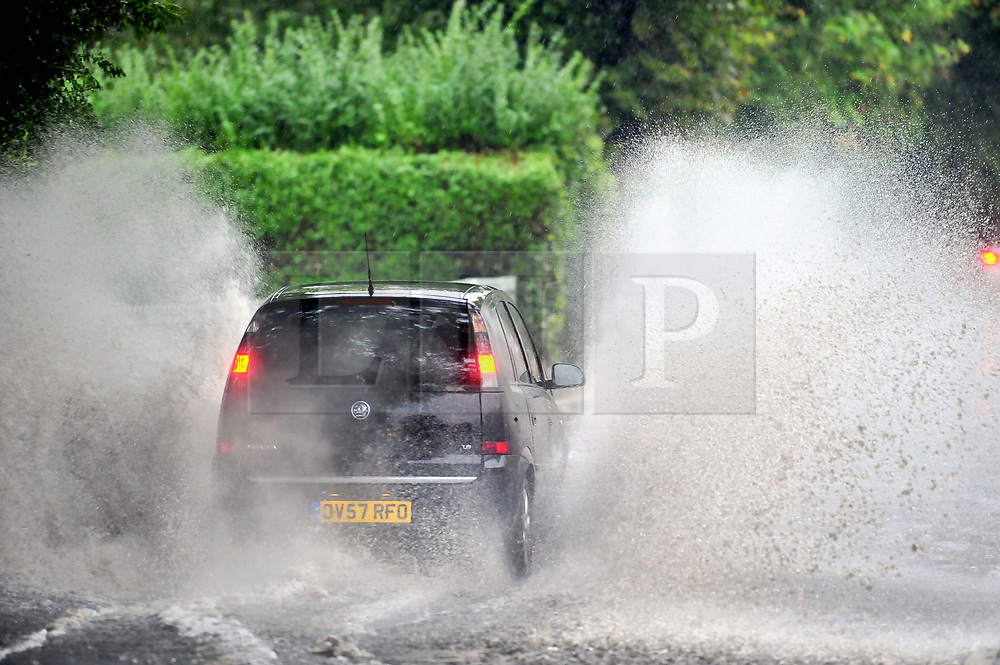© Licensed to London News Pictures. 23/09/2018<br /> St Mary Cray, UK. Traffic drives through surface water caused by heavy rain in St Mary Cray, South East London.<br /> Photo credit: Grant Falvey/LNP