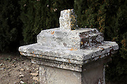 graveyard memorial pillar with missing cross