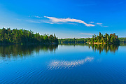 Clouds reflected in Blindfold Lake<br />Kenora DIstrict<br />Ontario<br />Canada