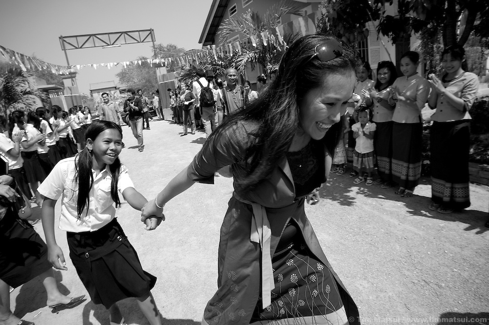 """AFESIP President Somaly Mam with girls rescued from sex trafficking at Tom Dy, a residential facility of the non governmental organization """"Acting for Women in Distressing Situations"""" (AFESIP), an """"A to Z"""" Cambodian relief agency providing outreach, health services, retraining and residential housing in Phnom Penh, Cambodia. AFESIP clients are victims of sex trafficking, ex-prostitutes, or domestically abused. Founded by Somaly Mam, who herself was once a prostitute and victim of trafficking and domestic abuse, AFESIP has three facilities in Cambodia and works with other NGO's to provide long term care for the women. An english translation of her autobiography will be released in September 2007."""