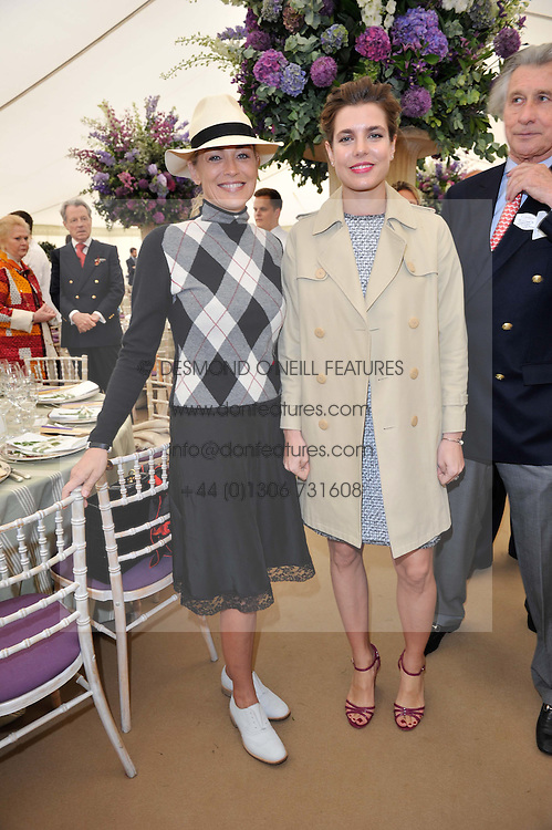 Left to right, SHARON STONE and CHARLOTTE CASIRAGHI at the 2013 Cartier Queens Cup Polo at Guards Polo Club, Berkshire on 16th June 2013.