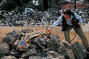 When a terrifying earthquake leveled part of Turkey in the fall of 1999, rescuers had trouble pulling victims from the rubble because it was too risky to crawl through the unstable ruins. As a result, some people died before they could be rescued. Shigeo Hirose of the Tokyo Technical Institute thinks he may have the solution: Blue Dragon (Souryu in Japanese). A light, triple-jointed robot with a digital camera in its nose, Blue Dragon could crawl through an earthquake-damaged building in search of survivors. Wriggling over a pile of shattered concrete on a construction site at the institute's campus, the battery-operated robot fell over several times, but righted itself quickly and continued slithering through the pile of stone. Japan. From the book Robo sapiens: Evolution of a New Species, page 148-149.
