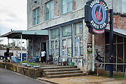 Cleaner at work at Morgan Freeman's Ground Zero Blues Club in Clarksdale, birthplace of the Blues, Mississippi USA