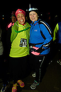East Meadow, New York, USA. December 31, 2014. YUWANNA LANDAU, of Merrick, and friend, at the stroke of midnight, are runners who will participate in a 5K New Year's Eve DASH to support the Long Island Council on Alcoholism and Drug Dependence (LICADD) at the Twin RInks Ice Center at Eisenhower Park in Long Island. A Skatin' New Year's Eve event started hours earlier and a New Year's Eve Party, open to runners, family and friends continued until 2:30 a.m.