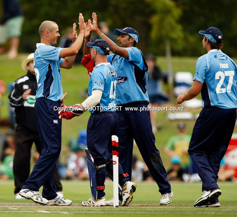 Auckland bowlers Chris Martin celebrates with Jeet Raval after getting the 9th wicket. Canterbury Wizards v Auckland Aces in the One Day Competition Final. QEII Park, Christchurch, New Zealand. Sunday, 13 February 2011. Joseph Johnson / PHOTOSPORT.
