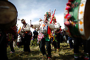 Indigenous supporters of Bolivia's president Evo Morales play native instruments as they attend a ceremony that recognizes Morales as the country's leader in Tiwanaku, Bolivia, Thursday, Jan. 21, 2010. Morales won general elections in December with 64% of the votes.