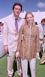 MISS VICTORIA TOMPKINS the Green Shield Stamp heiress and best friend of Jemima Goldsmith, and MR MARC FETIVEAU, at a polo match in Berkshire on 27th July 1997.MAR 56