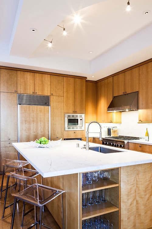 San Francisco interior photography by Kelly Vorves. Cream colored interior. Neutral kitchen with blond wood. Redesigned Pac Heights home.