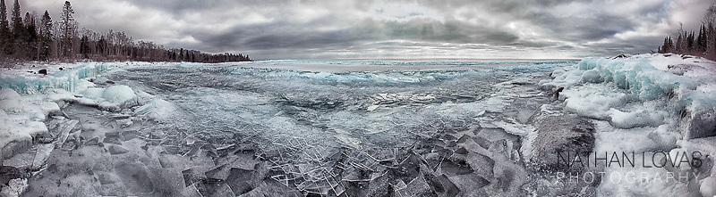 Sunrise on ice covered shoreline on Lake Superior;  MInnesota