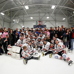 FORT FRANCES, ON - May 2, 2015 : Central Canadian Junior &quot;A&quot; Championship, game action between the Fort Frances Lakers and the Soo Thunderbirds, Ghampionship Game of the Dudley Hewitt Cup. The Soo Thunderbirds players, parents and fan celebrate with the Dudley Hewitt Cup.<br /> (Photo by Brian Watts / OJHL Images)