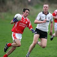 30/9/13 Eire Og's Paddy O Maley is under pressure from Ennistymon's Ciaran Devitt in their clash in Corrofin. Pic Tony Grehan / Press 22