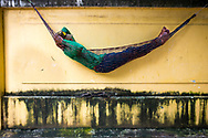 2 p.m in Phnom Penh, Cambodia. Khmer people enjoy very much sleep and rest on the hammock whenever is possible.<br /> Photo by Lorenz Berna