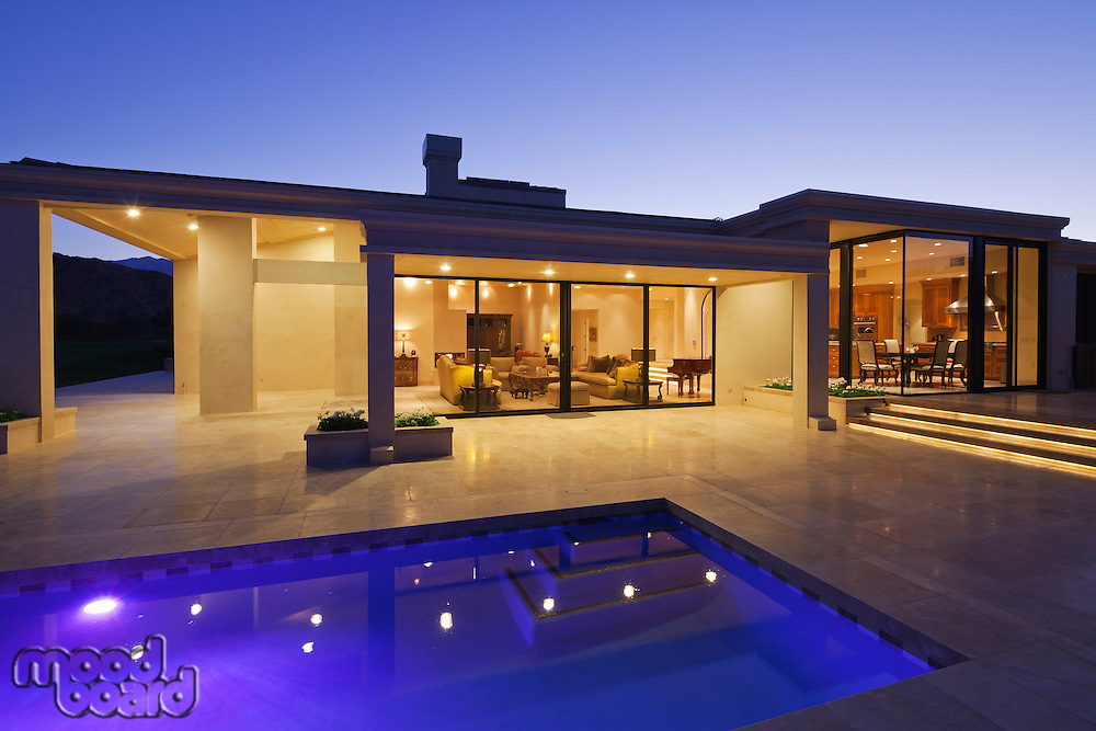 View inside modern home with swimming pool at dusk