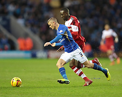 Leicester City's Paul Konchesky is challenged by Middlesbrough's Albert Adomah - Photo mandatory by-line: Nigel Pitts-Drake/JMP - Tel: Mobile: 07966 386802 25/01/2014 - SPORT - FOOTBALL - King Power Stadium - Leicester - Leicester City v Middlesbrough - Sky Bet Championship