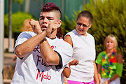 "30 JULY 2011 - PHOENIX, AZ:  NICK VELA, from Phoenix, AZ, dances in a flash mob in Phoenix Saturday. About 200 people showed up at Heritage Square in downtown Phoenix Saturday morning for a flash mob coordinated by the Arizona Science Center. The mob danced to several hip-hop songs before disbanding. The event was a part of National Dance Day Activities and the First Lady's ""Let's Move!"" physical fitness campaign.        PHOTO BY JACK KURTZ"