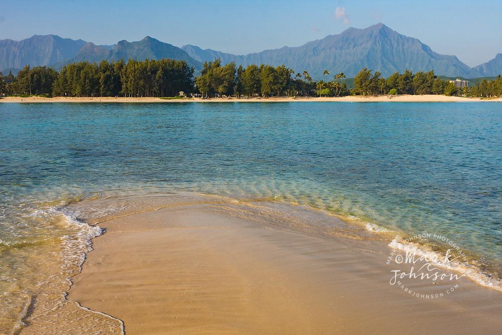 A calm windless morning in Kailua Bay, looking towards the Koolau Mountains, Oahu, Hawaii