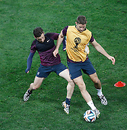 Leighton Baines (L) tackles Gary Cahill during the England training session at Arena Corinthians, Sao Paulo, Brazil, on the eve of their World Cup 2014 Group D match against Uruguay.<br /> Picture by Andrew Tobin/Focus Images Ltd +44 7710 761829<br /> 18/06/2014