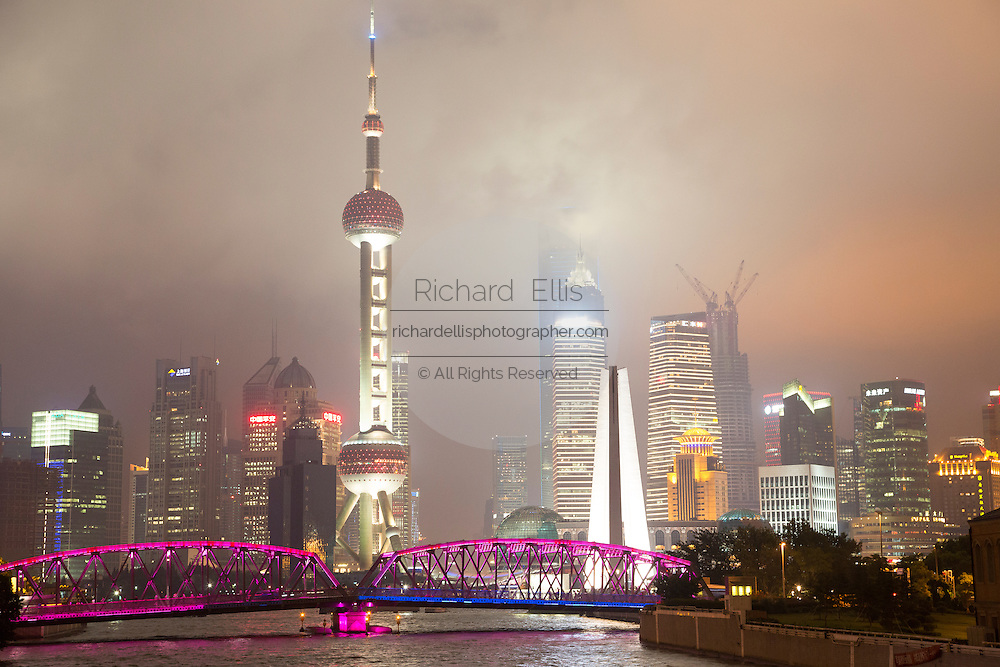 Colored lights on the Waibaidu Bridge with the Pudong skyline Shanghai, China