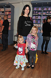 LIBERTY ROSS with her daughter SKYLA SAUNDERS (Taller) and niece DOMINO ROSS (in skirt) at a Hello Kitty Event at Liberty to lauch their collection of Hello Kitty products at Liberty, Great Marlborough Street, London on 25th September 2011.