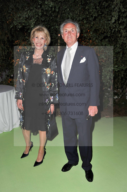 LORD & LADY HINDLIP at a dinner hosted by Cartier in celebration of the Chelsea Flower Show held at Battersea Power Station, 188 Kirtling Street, London SW8 on 23rd May 2011.