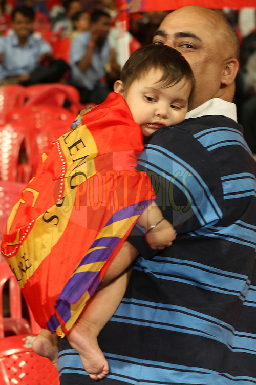 Young baby wrapped in RCB flag during match 21 of the the Indian Premier League ( IPL) 2012  between The Royal Challengers Bangalore and the Pune Warriors India held at the M. Chinnaswamy Stadium, Bengaluru on the 17th April 2012..Photo by Jacques Rossouw/IPL/SPORTZPICS