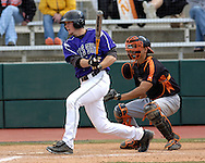Kansas State's Joe Roundy drives the ball up the middle in the bottom of the ningh inning against the Cowboys.  Oklahoma State defeated K-State 9-4 in 10 innings at Tointon Stadium in Manhattan, Kansas, April 30, 2006.
