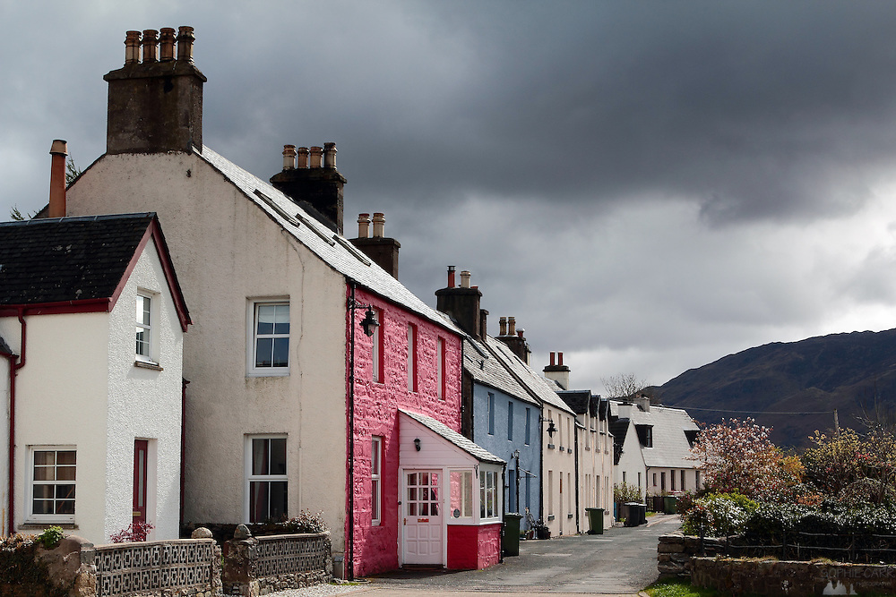 Colourful houses at the village of Dornie, near Eileen Donan Castle, near the Kyle of Lochalsh - gateway to the Isle of Skye, Scotland