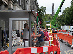 Edinburgh, Scotland, UK. 3 September, 2019. Film crew erecting new dummy bus shelter at Waterloo Place in Edinburgh prior to shooting for new Fast and Furious movie.
