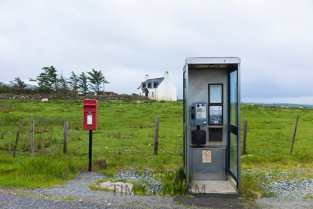 Traditional postbox and old-style public telephone box on Isle of Skye, the Western Isles of Scotland, UK