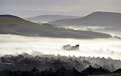 © Licenced to London News Pictures. 22-12-16 Lewes, East Sussex. Lewes castle emerging from mist  with the South Downs national park surrounding, East Sussex on a calm day before Storm Barbara hits the UK. Credit: Peter Cripps/LNP