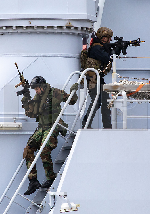 © Licensed to London News Pictures. 24/10/2018. London, UK. Royal Marine Commandos take part in a demonstration on the River Thames as part of the state visit by Dutch Royals King Willem-Alexander and Queen Maxima. Photo credit : Tom Nicholson/LNP
