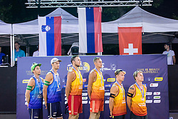 Second placed Nejc Zemljak and Jan Pokersnik, Winners Valeriy Samoday and Taras Myskiv, Third placed Florian Breer and Yves Haussener during during flower ceremony after the FIVB  Beach Volleyball World Tour Ljubljana 2018, on August 5, 2018 in Kongresni trg, Ljubljana, Slovenia. Photo by Ziga Zupan / Sportida