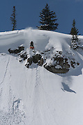 Brandon C. rolling off the diving board on his way to drop 60 plus feet on his Skidoo snowmobile in the southern Tetons on Bluebird day