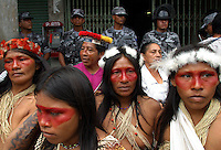 Huaorani Indians protest against Texaco in front of the court house in Lago Agrio, in northern Ecuador, on Tuesday October 21, 2003. Residents of Lago Agrio and neighboring towns, including many indigenous communities, claim that the U.S. oil company Texaco is responsible for contaminating the region during their years of operating the oil fields in the region. They are arguing in court that the contamination caused environmental damage and numerous cases of cancer and other illnesses throughout the area. (Photo/Scott Dalton)