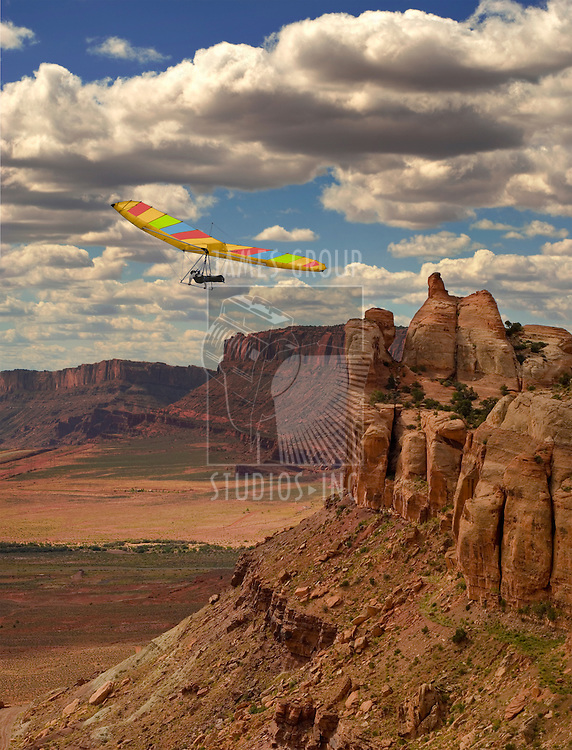 Fixed wing hang glider and pilot against spacious canyon landscape
